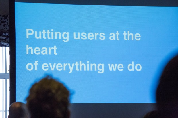 Presentation slide with the words 'Putting users at the heart of everything we do' on screen