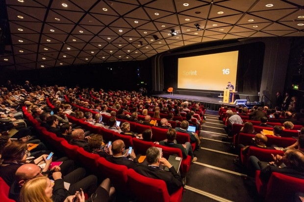 Image taken at Sprint 16 showing a stage with a full audience looking at the speaker